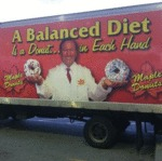 A Balanced Diet Is A Donut In Each Hand