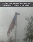 Tattered American Flag With A Security Camera...