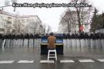 Man Playing Piano To Riot Police...
