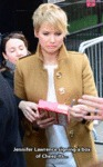 Jennifer Lawrence Signing A Box Of Cheez-its...