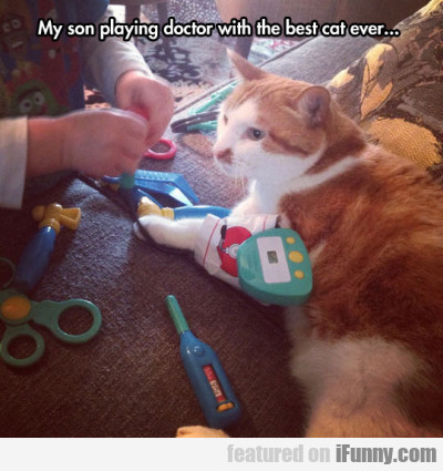 My son playing doctor with the best cat ever