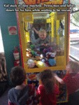 Kid Stuck In Claw Machine