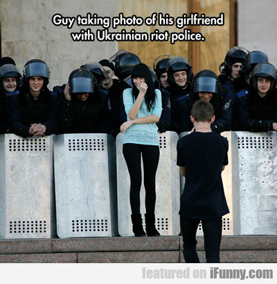 Guy Taking Photo Of His Girlfriend...