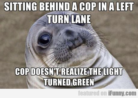 sitting behind a cop in a left turn lane...