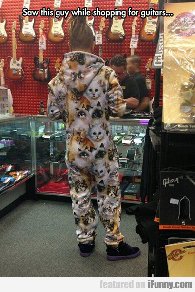 Saw This Guy While Shopping For Guitars...
