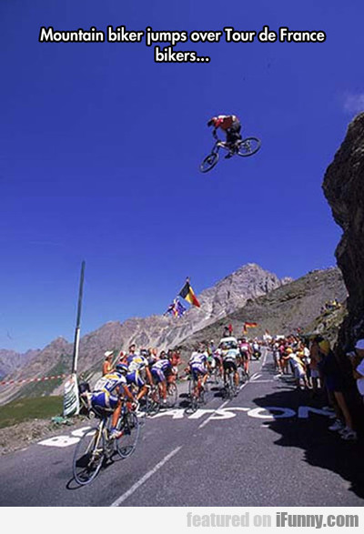 mountain biker jumps over...