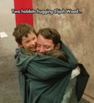 Two Hobbits Hugging Elijah Wood...