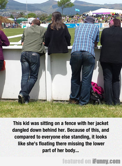 this kid was sitting on a fence...