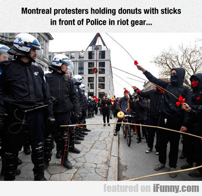 Montreal Protesters Holding Donuts...