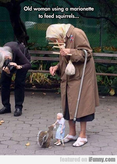 Old Woman Using A Marionette...