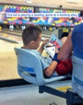 This Kid Is Playing A Bowling Game