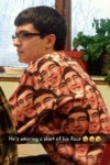 He's Wearing A Shirt Of His Face...