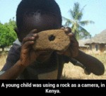 A Young Child Was Using A Rock As A Camera...