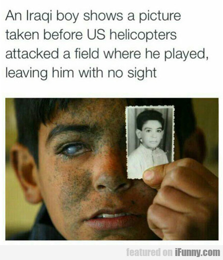 An Iraqi boy shows a picture