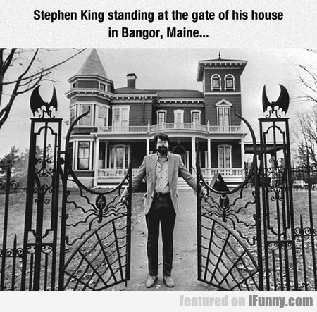 Stephen King Standing At The Gate Of His House