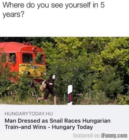 Man Dressed As Snail Races Hungarian Train And...