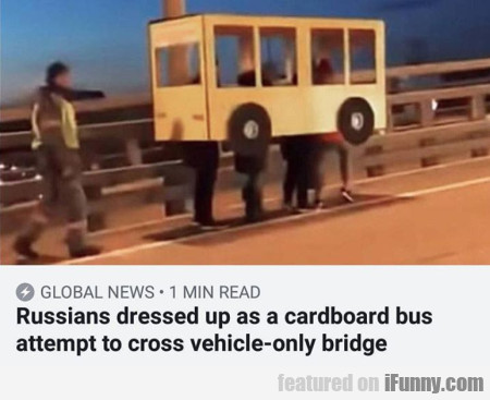 Russians Dressed Up As A Cardboard Bus