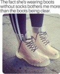 The Fact She's Wearing Boots Without Socks...